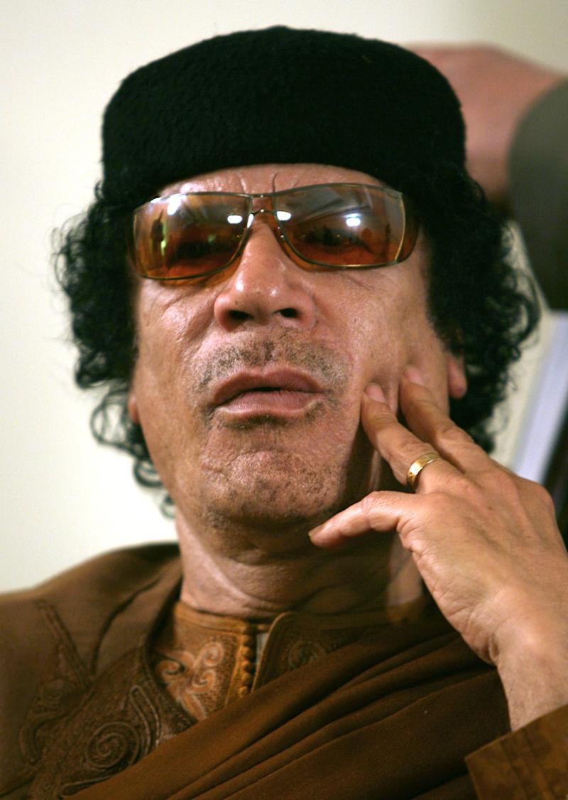 FILE.- This Friday, March 2, 2007 file photo shows Libya's Moammar Gadhafi  in Sabha, Libya Friday, March 2, 2007. The International Criminal Court issued arrest warrants Monday June 27, 2011, for Libyan leader Moammar Gadhafi, his son and his intelligence chief for crimes against humanity in the early days of their struggle to cling to power. (AP Photo/Nasser Nasser, File)