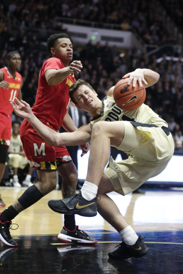 Purdue forward Grady Eifert (24) comes down with a rebound in front of Maryland guard Anthony Cowan Jr. during the second half of an NCAA college basketball game in West Lafayette, Ind., Thursday, Dec. 6, 2018. (AP Photo/Michael Conroy)