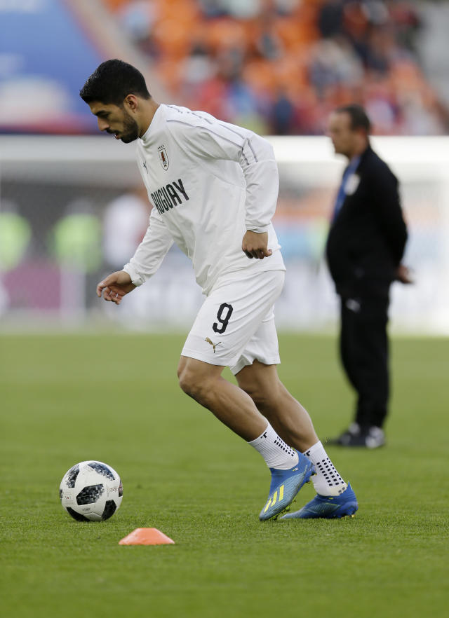 Uruguay's Luis Suarez warms up prior to the start of the group A match between Egypt and Uruguay at the 2018 soccer World Cup in the Yekaterinburg Arena in Yekaterinburg, Russia, Friday, June 15, 2018. (AP Photo/Natacha Pisarenko)
