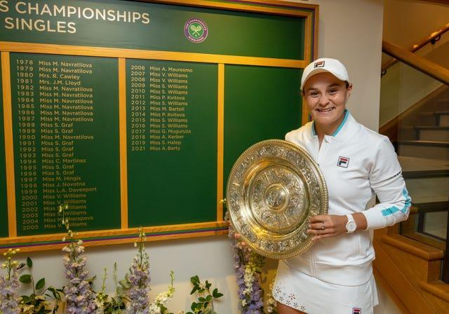 Ashleigh Barty poses next to the honours board
