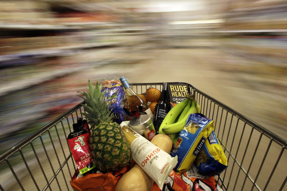 A shopping trolley is pushed around a supermarket in London, Britain May 19, 2015. Britain's annual rate of consumer price inflation fell below zero for the first time in more than half a century, official figures showed on Tuesday, though Bank of England Governor Mark Carney said the dip was likely to be brief. REUTERS/Stefan Wermuth