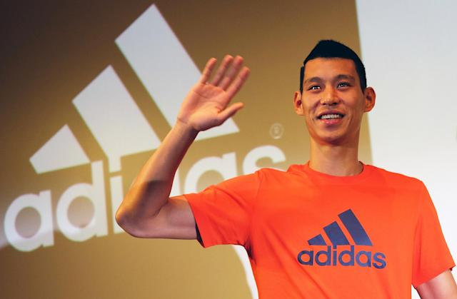 Basketball star Jeremy Lin at a press conference in Taipei on July 18, 2014 (AFP Photo/Sam Yeh)