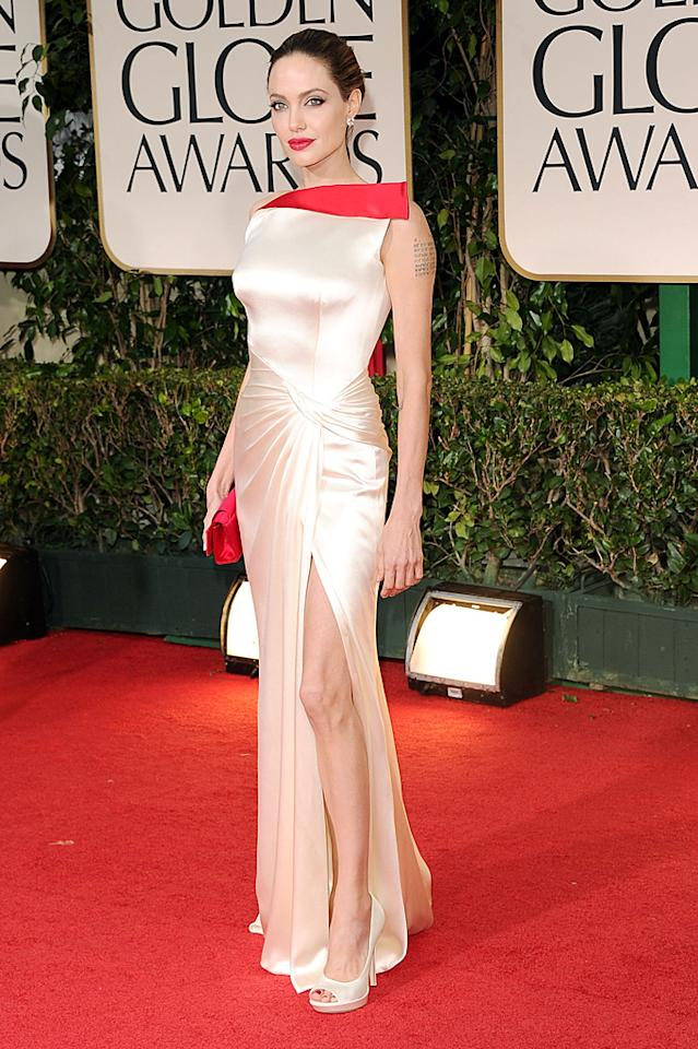 "<p class=""MsoNormal""><strong>Angelina Jolie</strong><br>  <strong>Grade: A+</strong><span><br></span></p><p class=""MsoNormal""><span>Angelina Jolie had jaws dropping in her dramatic white Atelier Versace gown, which featured a pop of bright red trim. The actress/director, whose movie ""In the Land of Blood and Honey"" was nominated for Best Foreign Film, accessorized with matching red lips, a Christian Louboutin ""Pharaon"" clutch, white Versace shoes, and Lorraine Schwartz earrings. Perfection!</span></p>"