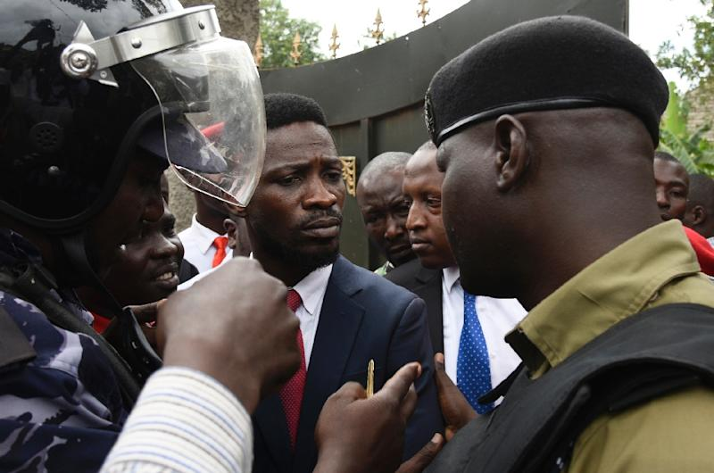 """Ugandan musician turned politician Robert Kyagulanyi, commonly known by his stage name Bobi Wine has been placed under """"preventive arrest"""", according to police (AFP Photo/ISAAC KASAMANI)"""