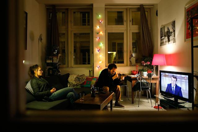 <p>A couple watches a live broadcast television debate with French centrist presidential candidate Emmanuel Macron, on the screen, and far-right candidate Marine Le Pen, in an apartment in Lyon, central France, Wednesday, May 3, 2017. Le Pen and Emmanuel Macron exchanged barbs and insults on Wednesday during their sole televised debate ahead of Sunday's runoff election. (AP Photo/Laurent Cipriani) </p>