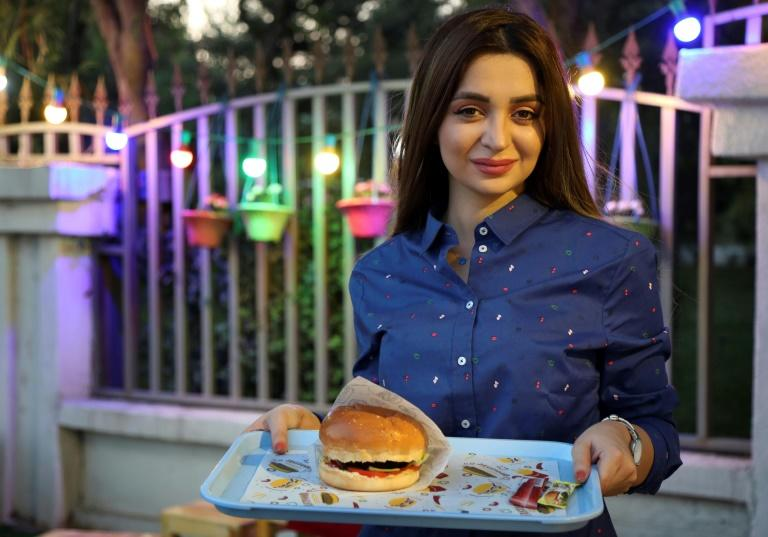Zilan Serwud, 22, needed family approval before opening her food truck selling burgers in Iraqi Kurdistan (AFP Photo/SAFIN HAMED)