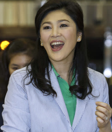 FILE PHOTO: Former Thai Prime Minister Yingluck Shinawatra smiles as she arrives at Bangkok's Suvarnabhumi Airport
