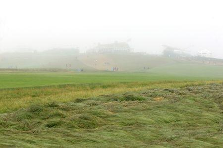 Jun 13, 2018; Southampton, NY, USA; General view of the first fairway as fog rolls in during Wednesday's practice round of the 118th U.S. Open golf tournament at Shinnecock Hills. Mandatory Credit: Brad Penner-USA TODAY Sports