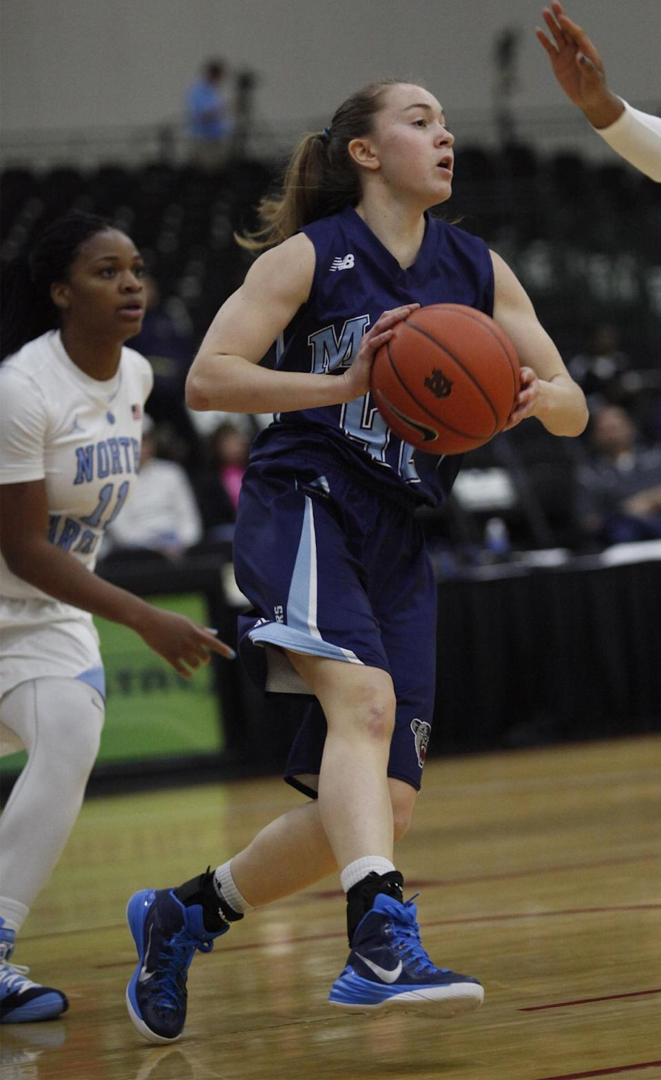 University of Maine's Sigi Koizar (43) looks to pass during the first half of an NCAA college basketball game, Friday, Dec. 19, 2014 in Myrtle Beach, S.C. (AP Photo/Randall Hill)