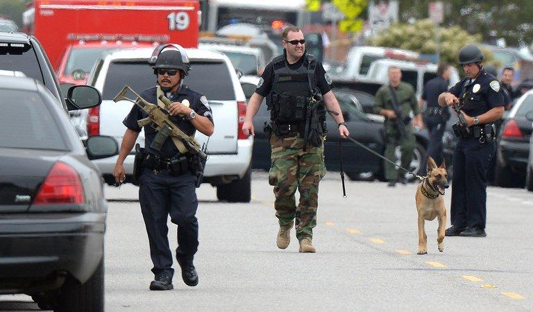 Police search the grounds of Santa Monica College June 7, 2013 in Santa Monica, California. At least six people were killed in a shooting rampage before police shot and killed the black-clad gunman in a college library, police said