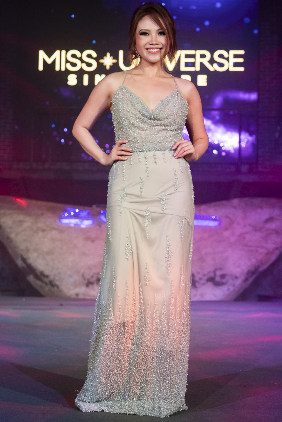 Nerrine Ng competing in the evening gown segment during the 2019 Miss Universe Singapore at Zouk.