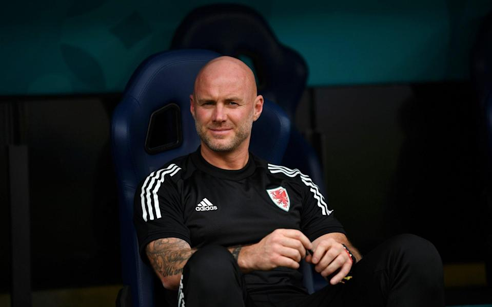 Rob Page in the dugout ahead of Wales' 1-0 defeat to Italy at the group stage - GETTY IMAGES