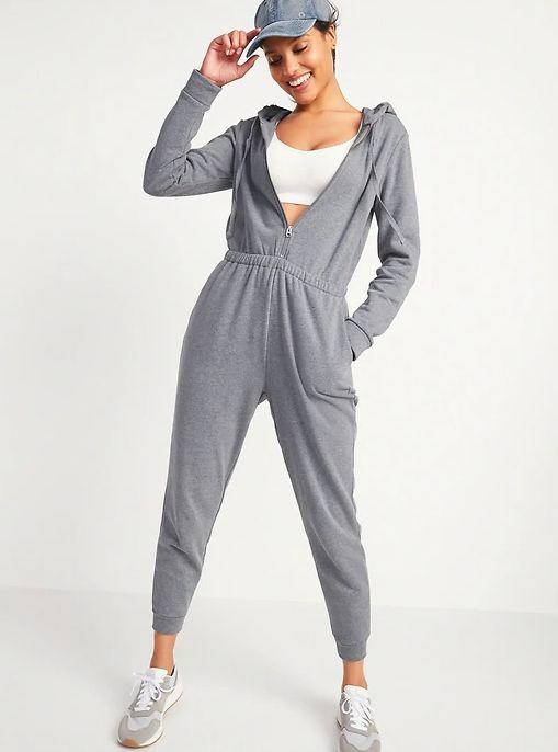 """This Cozy Zip-Front Hoodie Jumpsuit for Women is available in sizes XS to XXL and two colors. <a href=""""https://fave.co/3lnSg9t"""" target=""""_blank"""" rel=""""noopener noreferrer"""">Get it on sale for 50% off (normally $50) at Old Navy</a>."""