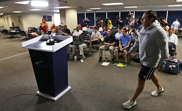 New England Patriots head coach Bill Belichick walks to the podium during a football news conference at Gillette Stadium in Foxborough, Mass., Wednesday, July 23, 2014. Patriots players reported to training camp with their first team practice scheduled for Thursday July 24th. (AP Photo)