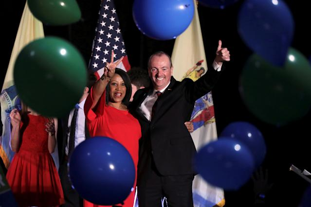 Phil Murphy, Governor-elect of New Jersey, and Shiela Oliver, Lieutenant Governor-elect, wave to supporters at their election night victory rally in Asbury Park, New Jersey on November 7, 2017. (Photo: Dominick Reuter/Reuters)