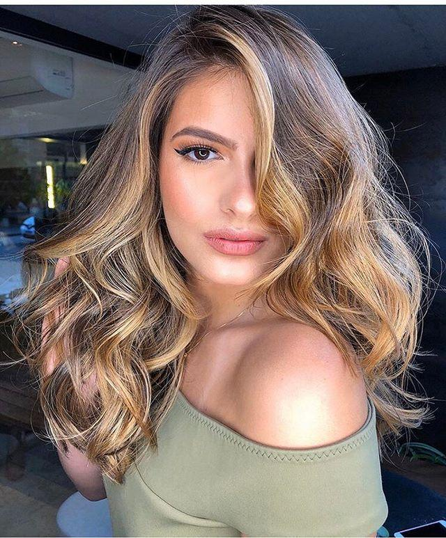 """<p>Streaks of caramel give the usual deep brown autumn fave a glow-up.</p><p><a href=""""https://www.instagram.com/p/CAME3IQnJqd/?utm_source=ig_embed&utm_campaign=loading"""" rel=""""nofollow noopener"""" target=""""_blank"""" data-ylk=""""slk:See the original post on Instagram"""" class=""""link rapid-noclick-resp"""">See the original post on Instagram</a></p>"""