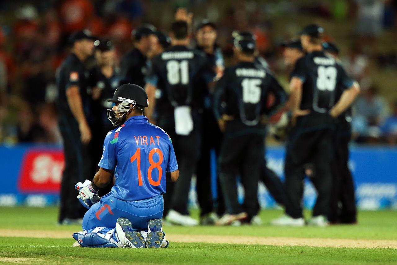 NAPIER, NEW ZEALAND - JANUARY 19:  Virat Kohli of India looks on after the dismissal MS Dhoni during the first One Day International match between New Zealand and India at McLean Park on January 19, 2014 in Napier, New Zealand.  (Photo by Hagen Hopkins/Getty Images)