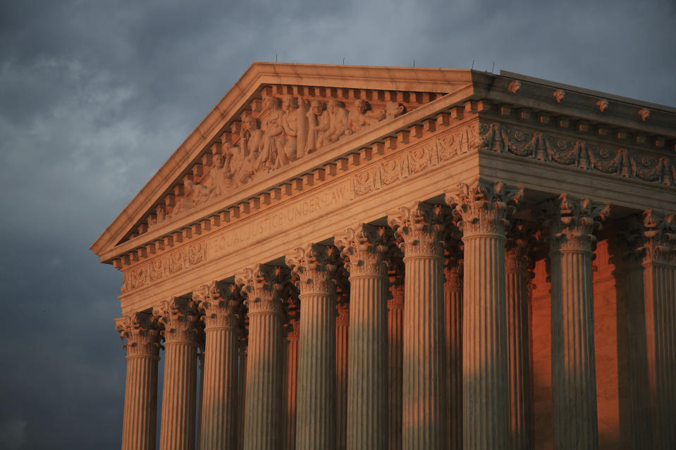 FILE - In this Oct. 4, 2018, file photo, the U.S. Supreme Court is seen at sunset in Washington. The Supreme Court is siding with Google in an $8 billion copyright dispute with Oracle. The justices sided with Google 6-2 on April 5, 2021. The case has to do with Google's creation of the Android operating system now used on the vast majority of smartphones worldwide. (AP Photo/Manuel Balce Ceneta, File)