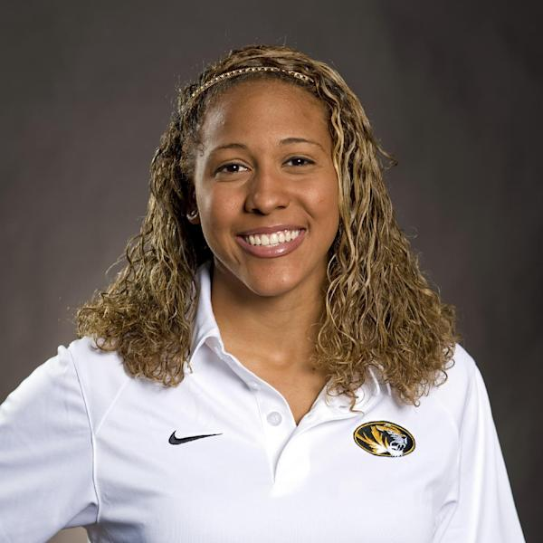 In this 2010 photo provided by the University of Missouri Athletic Department is Sasha Menu Courey. The Canadian family of former University of Missouri school swimmer says the school and its athletics department failed to properly investigate her alleged off-campus rape by as many as three football players in 2010. Menu Courey struggled with mental illness and committed suicide 16 months later. (AP Photo/University of Missouri Athletic Department)