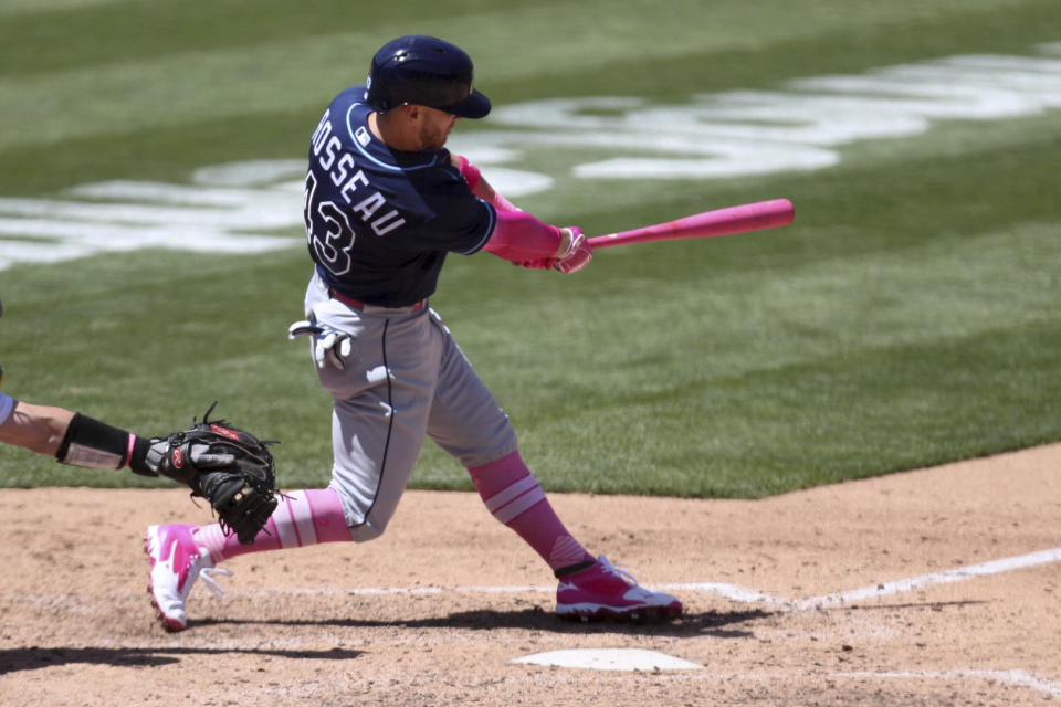 Tampa Bay Rays' Mike Brosseau hits a solo home run against the Oakland Athletics during the sixth inning of a baseball game in Oakland, Calif., Sunday, May 9, 2021. (AP Photo/Jed Jacobsohn)