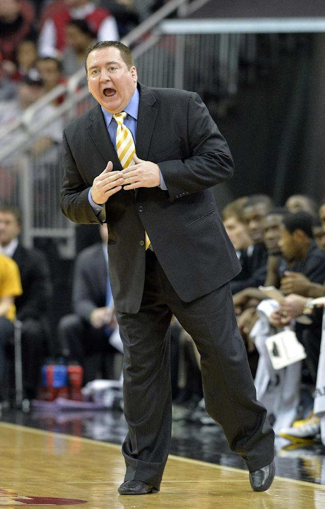 Southern Mississippi head coach Donnie Tyndall shouts instructions to his team during the first half of an NCAA college basketball game Friday, Nov. 29, 2013, in Louisville, Ky. (AP Photo/Timothy D. Easley)