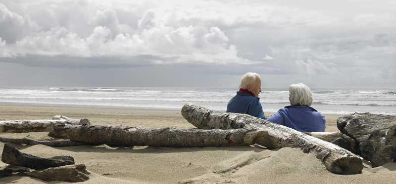 Retired couple on the beach.