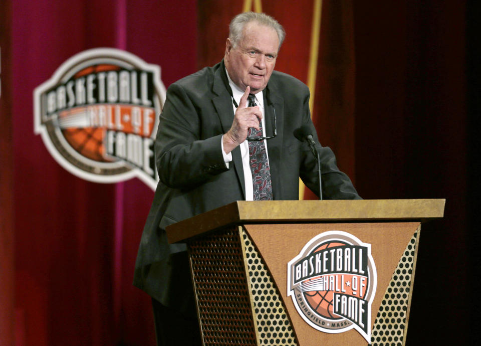 FILE - In this Sept. 11, 2015, file photo, Basketball Hall of Fame inductee Tommy Heinsohn gestures during the enshrinement ceremony for the Class of 2015 at the Naismith Memorial Basketball Hall of Fame in Springfield, Mass. Tommy Heinsohn, who as a Boston Celtics player, coach and broadcaster was with the team for all 17 of its NBA championships, has died. He was 86. The team confirmed Heinsohn's death on Tuesday, Nov. 10, 2020. (AP Photo/Charles Krupa, File)