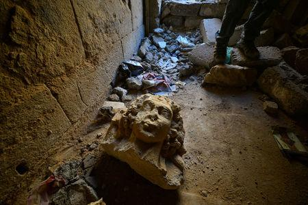 A destroyed artifact is seen at the ancient city of Hatra