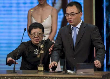 "Ann Hui On Wah reacts after winning the Best Film award for her movie ""The Golden Era"" during the Hong Kong Film Awards"