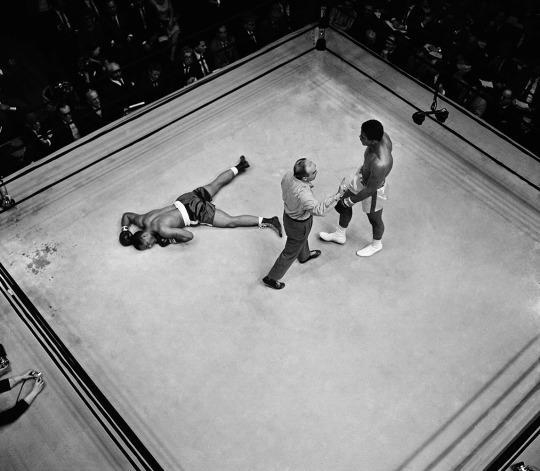 <p>Referee John LoBianco directs champion Muhammad Ali to a neutral corner before he started the knockout count over prostrate challenger Zora Folley in seventh round of heavyweight little fight. Ali was declared victor on a knockout at 1:48 of the round in fight in New York's Madison Square Garden, March 22, 1967. (AP Photo)</p>