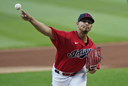 Cleveland Indians starting pitcher Carlos Carrasco delivers in the first inning in a baseball game against the Milwaukee Brewers, Friday, Sept. 4, 2020, in Cleveland. (AP Photo/Tony Dejak)