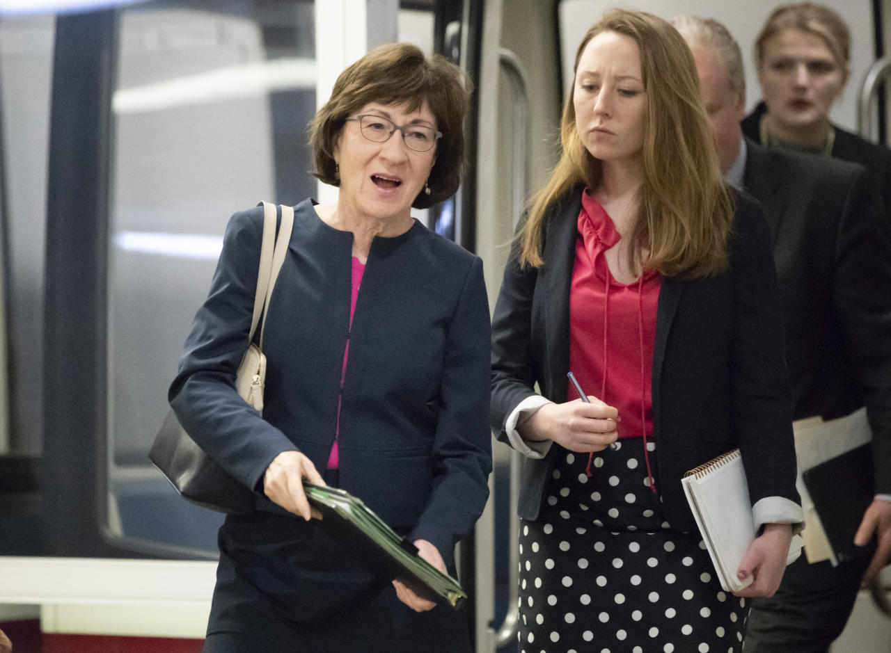 Sen. Susan Collins, R-Maine, and other senators arrive to vote on a bill to expand private care for military veterans as an alternative to the troubled Veterans Affairs health system, on Capitol Hill in Washington, Wednesday, May 23, 2018. (AP Photo/J. Scott Applewhite)