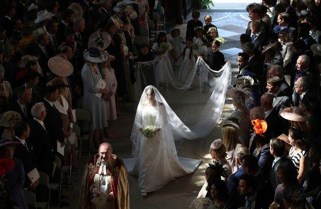 Meghan walks down the aisle on her wedding day.