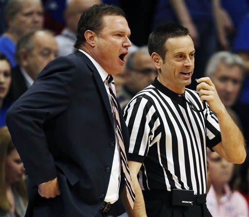 Kansas coach Bill Self talks with an official during the first half of an NCAA college basketball game against Texas Tech in Lawrence, Kan., Saturday, Feb. 18, 2012. (AP Photo/Orlin Wagner)