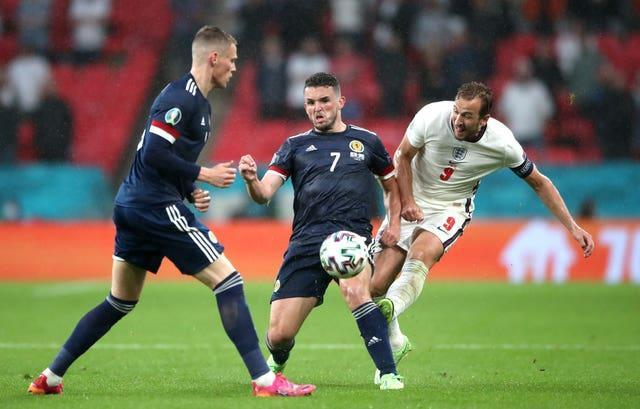 Harry Kane, right, is crowded out by Scotland's John McGinn, centre, and Scott McTominay