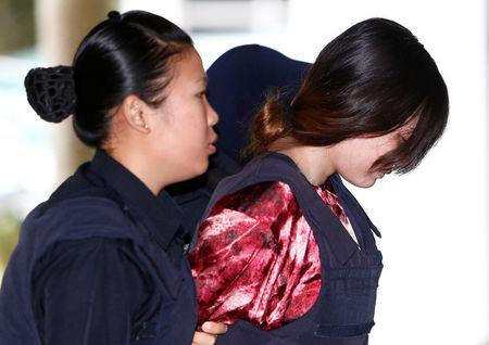 Vietnamese Doan Thi Huong, who is on trial for the killing of Kim Jong Nam, the estranged half-brother of North Korea's leader, is escorted as she arrives at the Shah Alam High Court on the outskirts of Kuala Lumpur, Malaysia January 22, 2018. REUTERS/Lai Seng Sin