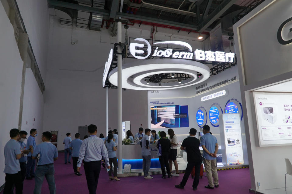 Shanghai-based testing kit company BioGerm presents a booth at a trade fair in Nanchang in eastern China's Jiangxi province on Friday, Aug. 21, 2020. BioGerm was one of three companies that gained privileged access to crucial information on the coronavirus from the Chinese Center for Disease Control and Prevention at the beginning of the outbreak, allowing them to make kits ahead of competitors. The move delayed China's response to the outbreak and caused critical shortages of kits. (AP Photo/Dake Kang)