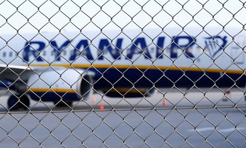 An aircraft of low-cost airliner Ryanair is seen behind a fence while being parked at the tarmac of Weeze airport near the German-Dutch border during a wider European strike of Ryanair airline crews