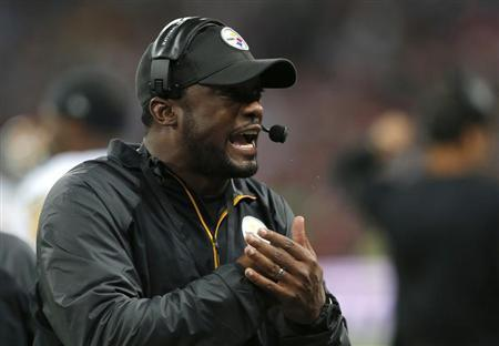 Pittsburgh Steelers head coach Tomlin directs his team's play in the third quarter of play against the Minnesota Vikings during their NFL football game at Wembley Stadium in London