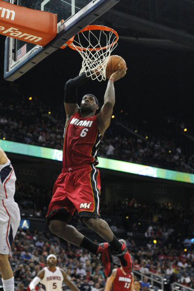 Miami Heat forward LeBron James (6) slams in the first half of a preseason NBA basketball game Sunday, Oct. 7, 2012 in Atlanta. (AP Photo/Todd Kirkland)