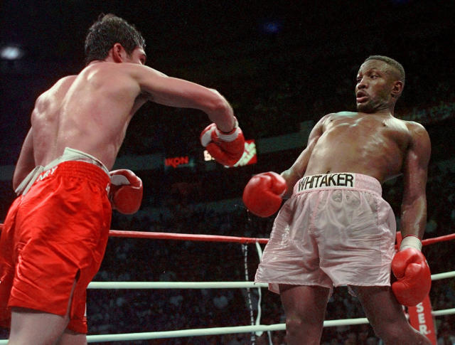 FILE - In this April 12, 1997, file photo, Pernell Whitaker, right, leans away from a punch by Oscar De La Hoya during their WBC Welterweight Championship fight at Thomas & Mack Center in Las Vegas. De La Hoya won by unanimous decision. Former boxing champion Pernell Whitaker has died after he was hit by a car in Virginia. He was 55. Police in Virginia Beach on Monday say Whitaker was a pedestrian when struck by the car Sunday night, July 14, 2019. The driver remained on the scene, where Whitaker was pronounced dead. (AP Photo/Eric Draper, File)