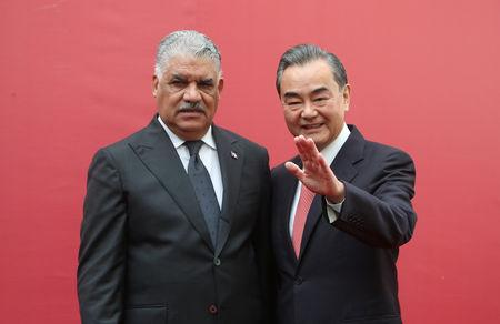 China's Foreign Minister Wang Yi and Dominican Republic's Chancellor Miguel Vargas pose during the opening of the first Chinese Embassy in the Dominican Republic, in Santo Domingo, Dominican Republic, September 21, 2018. REUTERS/Ricardo Rojas
