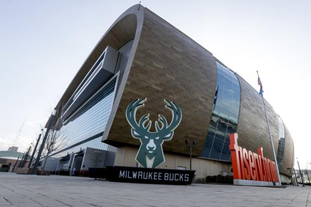 Fiserv Forum stands Thursday March 12, 2020, in Milwaukee. The NBA has suspended its season. The Milwaukee Bucks had been scheduled to play the Boston Celtics on Thursday night at the arena. (AP Photo/Morry Gash)
