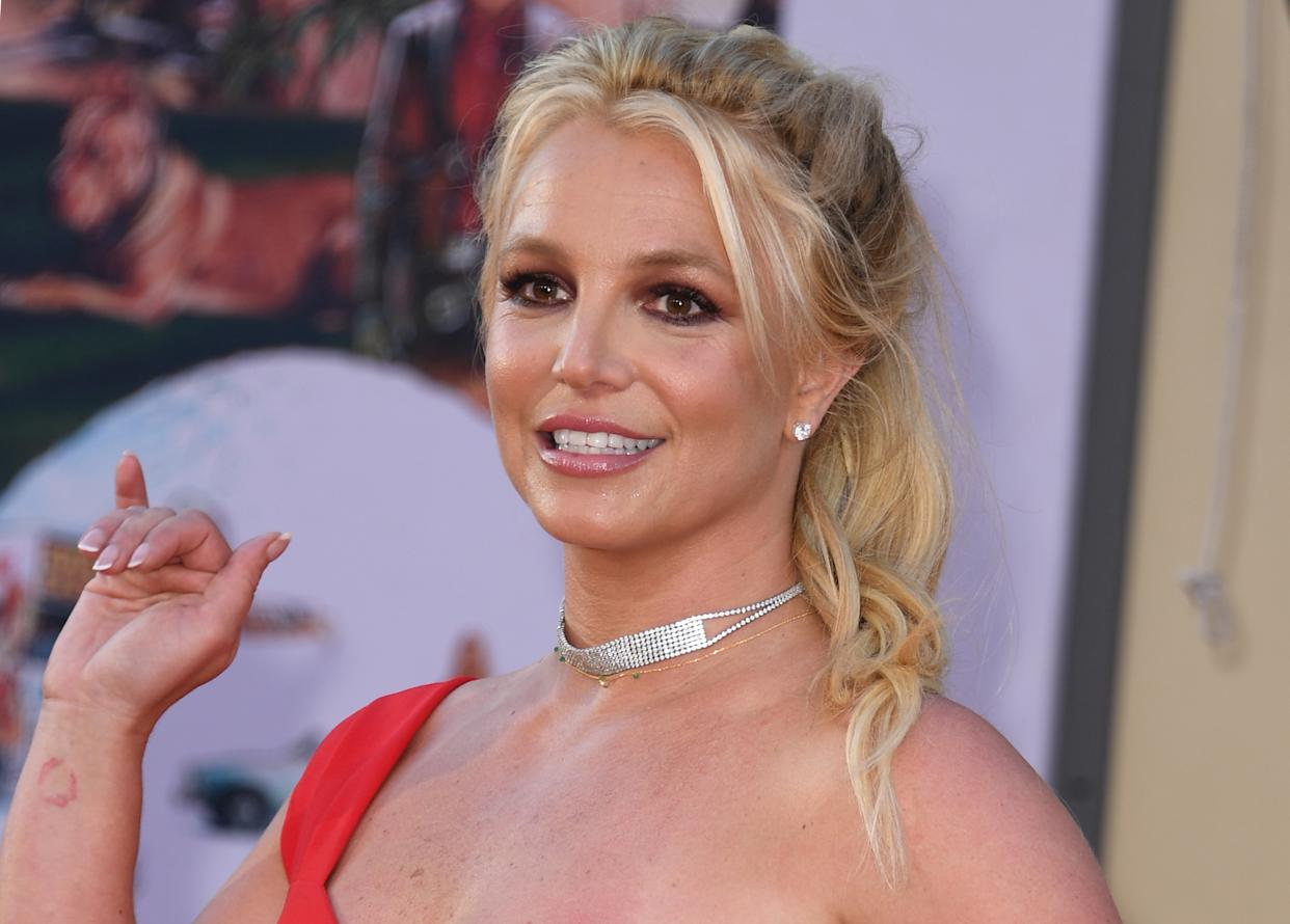 """US singer Britney Spears arrives for the premiere of Sony Pictures' """"Once Upon a Time... in Hollywood"""" at the TCL Chinese Theatre in Hollywood, California on July 22, 2019. (Photo by VALERIE MACON / AFP)        (Photo credit should read VALERIE MACON/AFP/Getty Images)"""