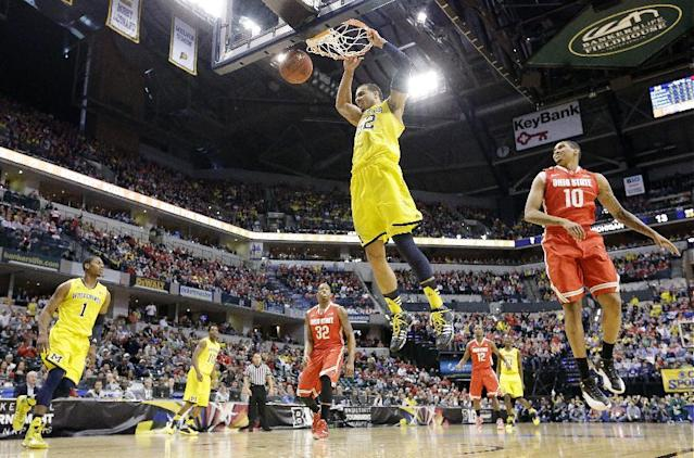 Michigan forward Jordan Morgan (52) dunks against Ohio State in the first half of an NCAA college basketball game in the semifinals of the Big Ten Conference tournament Saturday, March 15, 2014, in Indianapolis. (AP Photo/Michael Conroy)