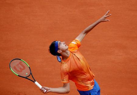 Tennis - French Open - Roland Garros, Paris, France - May 26, 2019 Italy's Lorenzo Sonego in action during his first round match against Switzerland's Roger Federer REUTERS/Christian Hartmann