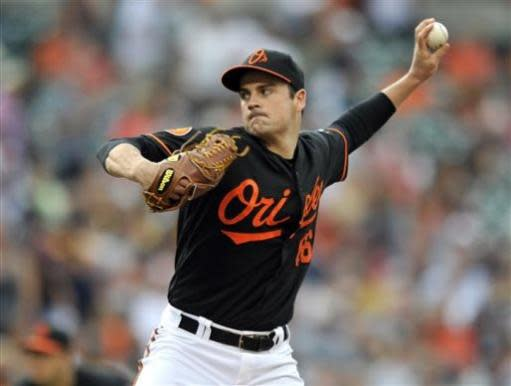 Baltimore Orioles starting pitcher T.J. McFarland delivers against the New York Yankees in the first inning of a baseball game, Friday, June 28, 2013, in Baltimore. (AP Photo/Gail Burton)