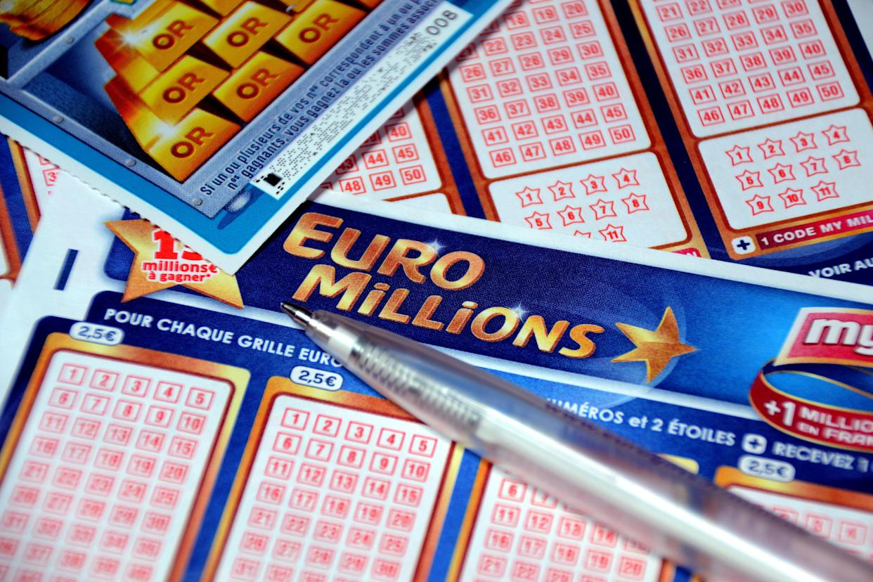 In this photo illustration a pen and a scratch card on Euromillions tickets. A couple of Alsatians pocketed the 157 million euros of the Euromillions draw of September 1, 2020. (Photo by Gerard Bottino / SOPA images/Sipa USA)
