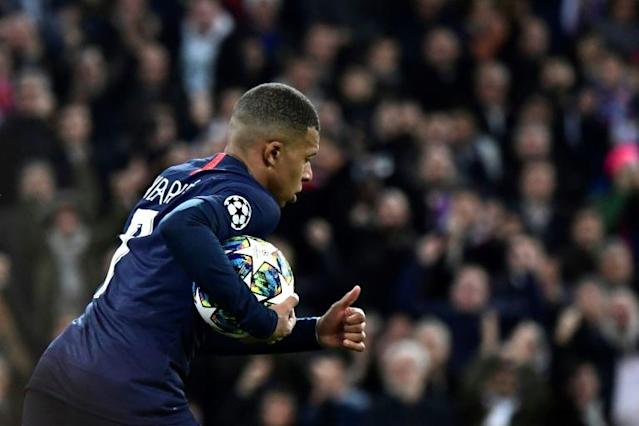 Kylian Mbappe helped Paris Saint-Germain come back to grab a 2-2 draw against Real Madrid on Tuesday (AFP Photo/JAVIER SORIANO)