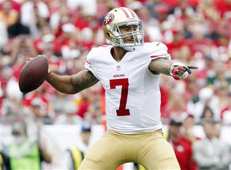 Dec 15, 2013; Tampa, FL, USA; San Francisco 49ers quarterback Colin Kaepernick (7) throws the ball against the Tampa Bay Buccaneers during the first half at Raymond James Stadium. Kim Klement-USA TODAY Sports